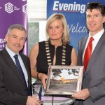 REPRO FREE 06/11/2015 Claire Nash President Cork Business Association presenting the Public Choice Award for the Quagrangle UCC to Mark Poland Director of Buildings and Estates and Rónán Ó Dubhghaill Vice President for External Relations at the CBA Cork Better Building Awards 2015 presentation lunch at the Hayfield Manor, Cork. Photo: Billy macGill