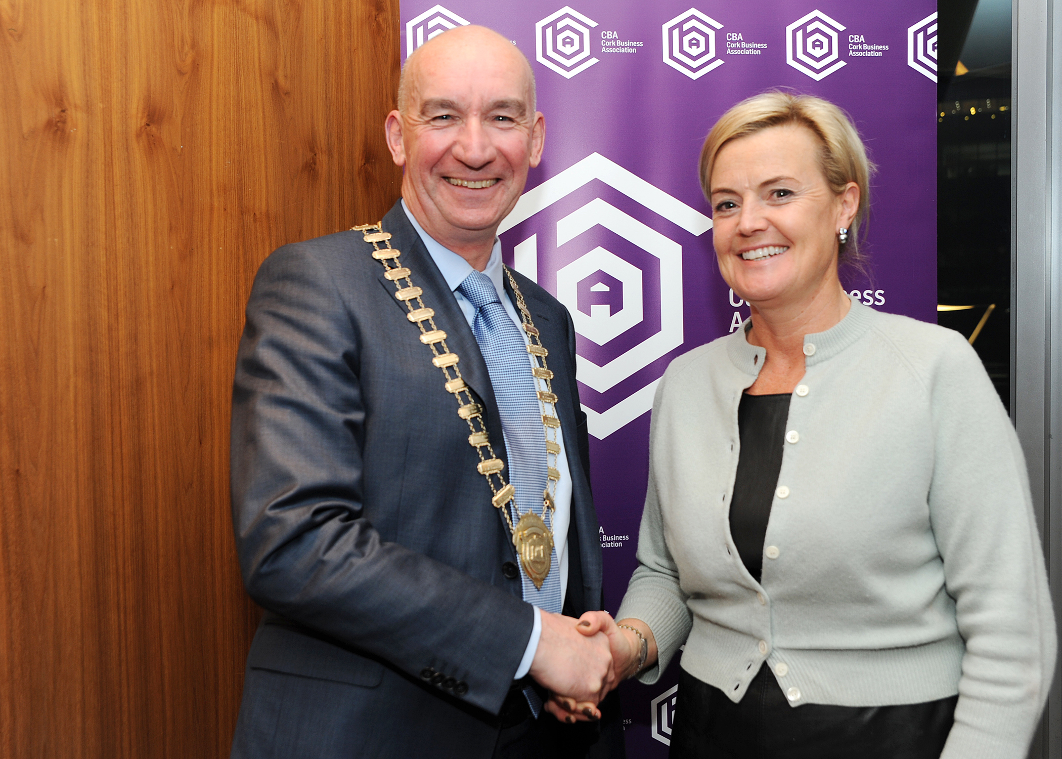 Pat O'Connell the incoming president of the Cork Business Association being congratulated by outgoing president Claire Nash at the associations AGM. Photo Billy macGill.