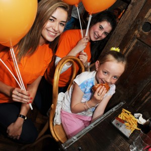 Eight year old Ava Goulding from Garveys Bridge enjoying her free meal at Coqbull French Church Street with Maeve Molloy and Kaite O'Flaherty during the Feel Good Friday party day in Cork. The event takes place on the last Friday of every month. Photo Billy macGill
