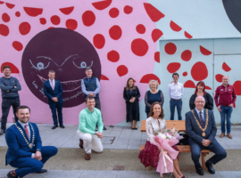 The Lord Mayor, Lady Mayoress and CBA President posing on Halrey Street with members of the Victorian Quarter.