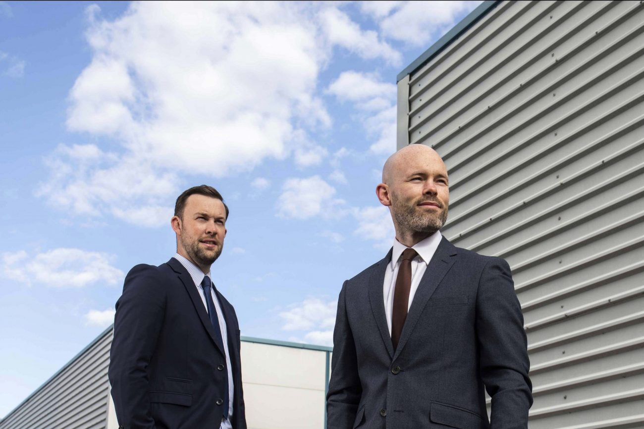 Eoin and Patrick O'Sullivan from M & P O'Sullivan in front of their company's warehouse